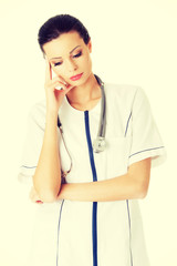 Thoughtful young woman doctor.