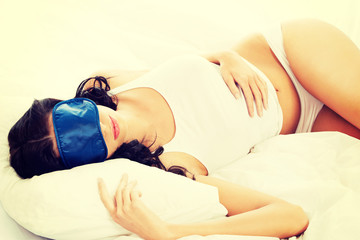 Beautiful woman sleeping on bed.