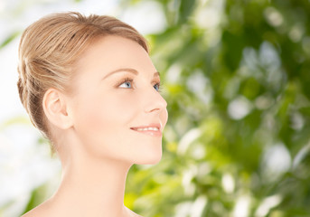 beautiful young woman face over green background