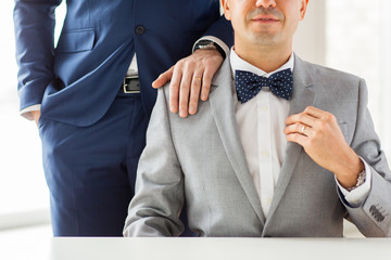close up of male gay couple with wedding rings on