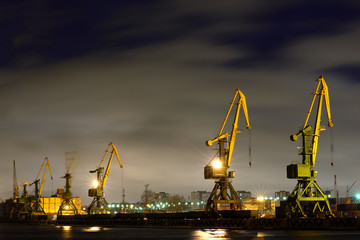 Many port crane in wintertime at night, Saint - Petersburg