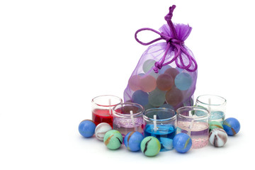 bag with stones and candles on a white background on the right