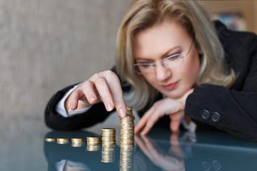 Businesswoman build euro columns