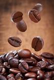 Closeup of falling coffee beans