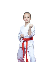 Karate girl preparing for a fight on a white background