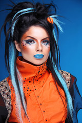 Makeup. Rock hairstyle. Portrait of young beautiful punk model w