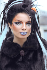 Beauty fashion punk teen girl portrait with art makeup and rock