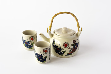 Chinese teapot with two cups isolated