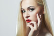 Blond woman with manicure.Beautiful girl model with red lips
