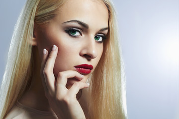 Blond woman with manicure.Beautiful girl model with make-up