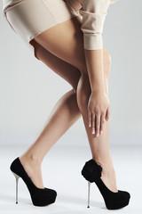 long sexy woman legs in high heels.Manicure.Black shoe