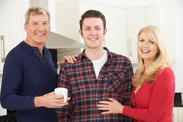 Portrait Of Family With Adult Son At Home