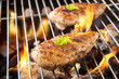 Marinated grilled chicken on the flaming grill