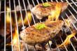 Leinwandbild Motiv Marinated grilled chicken on the flaming grill