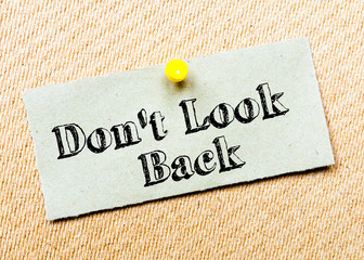 Recycled paper note on cork board. Don't Look Back message