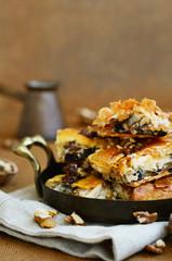 Tray with baklava - Turkish sweet with honey, walnut and raisin