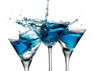 Three blue cocktails splash