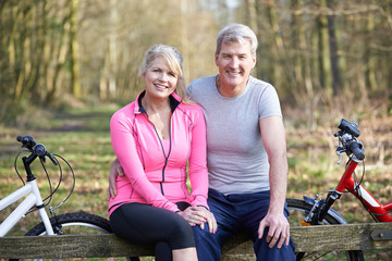Mature Couple On Cycle Ride In Countryside Together