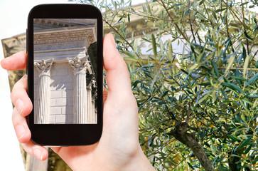 tourist taking photo of temple Maison Carree