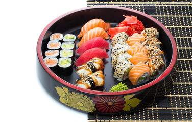 Sushi on black bamboo mat with place for your text