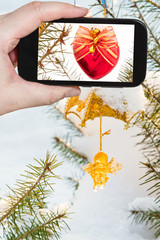 taking photo of Christmas tree decoration outdoors
