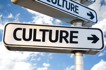 Culture direction sign on sky background