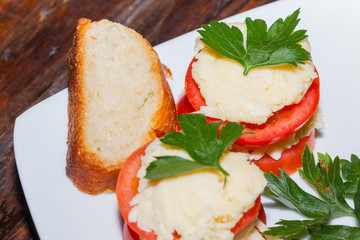Delicious appetizer, stuffed tomatoes with cream cheese