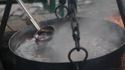 huge copper cauldron with tasty mulled wine