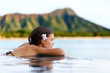 Infinity pool resort woman relaxing at beach - 79367633
