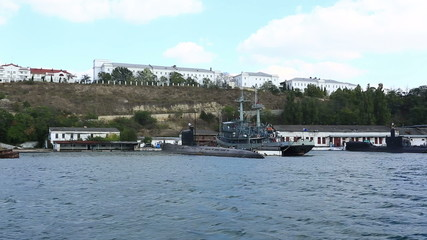 submarine and warship on anchor parking in a bay of Sevastopol