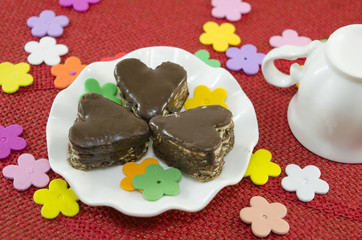 Heart shaped chocolate cookies on a plate