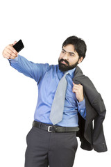 Young indian businessman taking a selfie