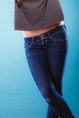Part of body female hips. Woman in jeans