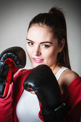 Fit woman boxing.
