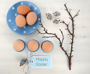 Easter blue and white table with fresh eggs