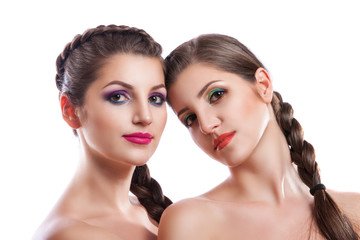 Close-up beauty portrait of two beautiful young women