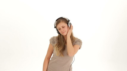 Young Pretty Lady In Earphones Listening to Music And Dancing