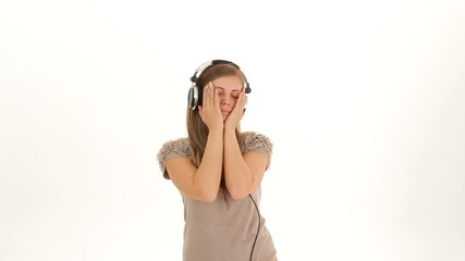 Young Pretty Girl In Earphones Listening to Music