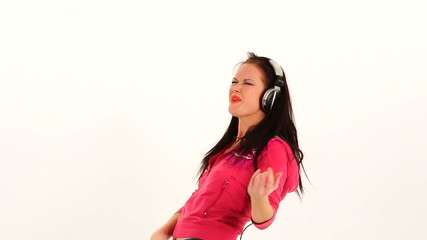 Young Woman Listening to Music With Earphones And Playing