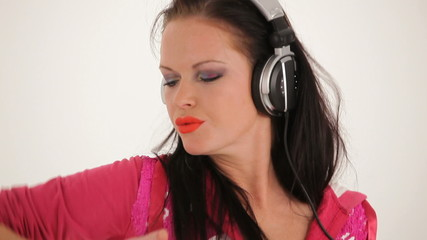 Portrait of Young Beautiful Woman Listening to Music With