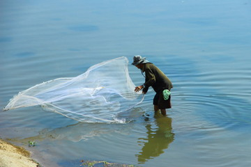 A man throw net for catching fish