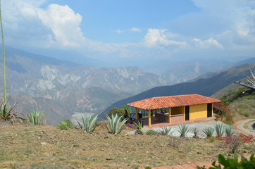 small house in mountains in latin america