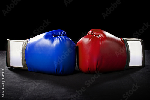 Fotobehang Extreme Sporten boxing gloves or martial arts gear on a black background