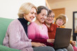 Female pensioners with laptop indoor