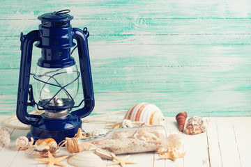 Lamp and marine items on wooden background