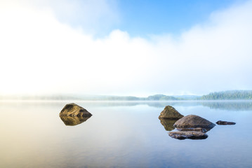 Early and harmonious morning with fog over the lake