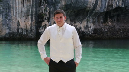 groom in black trousers and white shirt vest