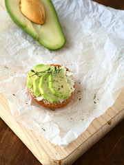 Fresh avocado on a wooden board