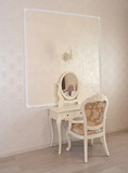 Fototapety Dressing table and white chair in a hotel room