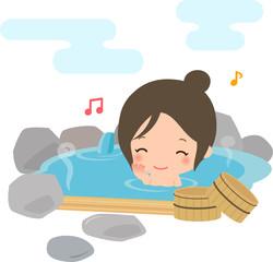 岩風呂に浸かる笑顔の女性